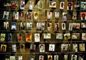 Pictures of killed people donated by survivors are installed on a wall inside the Gisozi memorial in Kigali April 5, 2004 which depicts the country's 1994 genocide in which 800,000 Tutsi and politically moderate Hutus died. Rwandans hungry for justice demanded tougher efforts to track down and punish killers who carried out the 1994 genocide, saying there could be no reconciliation while suspects were still at large. REUTERS/Radu Sigheti